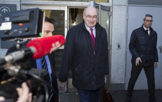 European Commissioner for Agriculture and Rural Development, Phil Hogan (C) leaves following a meeting with a delegation of French farmers, along with the French Agriculture Minister, at the French annual farm show (Salon International de l'Agriculture) on March 2, 2016 in Paris. / AFP / Geoffroy Van der Hasselt        (Photo credit should read GEOFFROY VAN DER HASSELT/AFP/Getty Images)