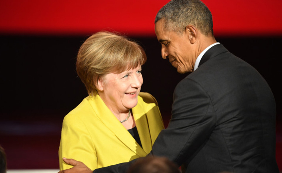 HANOVER, GERMANY - APRIL 24:  German chancellor Angela Merkel and U.S. President Barack Obama are seen on stage at the opening evening of the Hannover Messe trade fair on April 24, 2016 in Hanover, Germany. Obama met with German Chancellor Angela Merkel in Hanover earlier in the day and is scheduled to tour exhibition halls at the fair tomorrow. Hannover Messe is the world's largest industrial trade fair.  (Photo by Alexander Koerner/Getty Images)