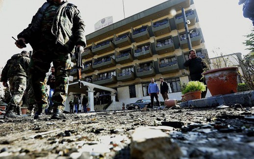 Syrian security forces inspect the site of a suicide attack at a police officer's club in the Masaken Barzeh district of the capital Damascus on February 9, 2016.     The Syrian Observatory for Human Rights said about 20 people had also been wounded, adding that policemen were among the dead and injured.   / AFP / LOUAI BESHARA        (Photo credit should read LOUAI BESHARA/AFP/Getty Images)